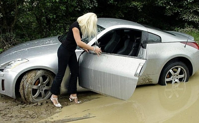 Blonde woman stuck in mud